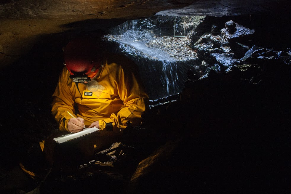 An MSS Cooperator sketching the entrance to a Perry County Cave.